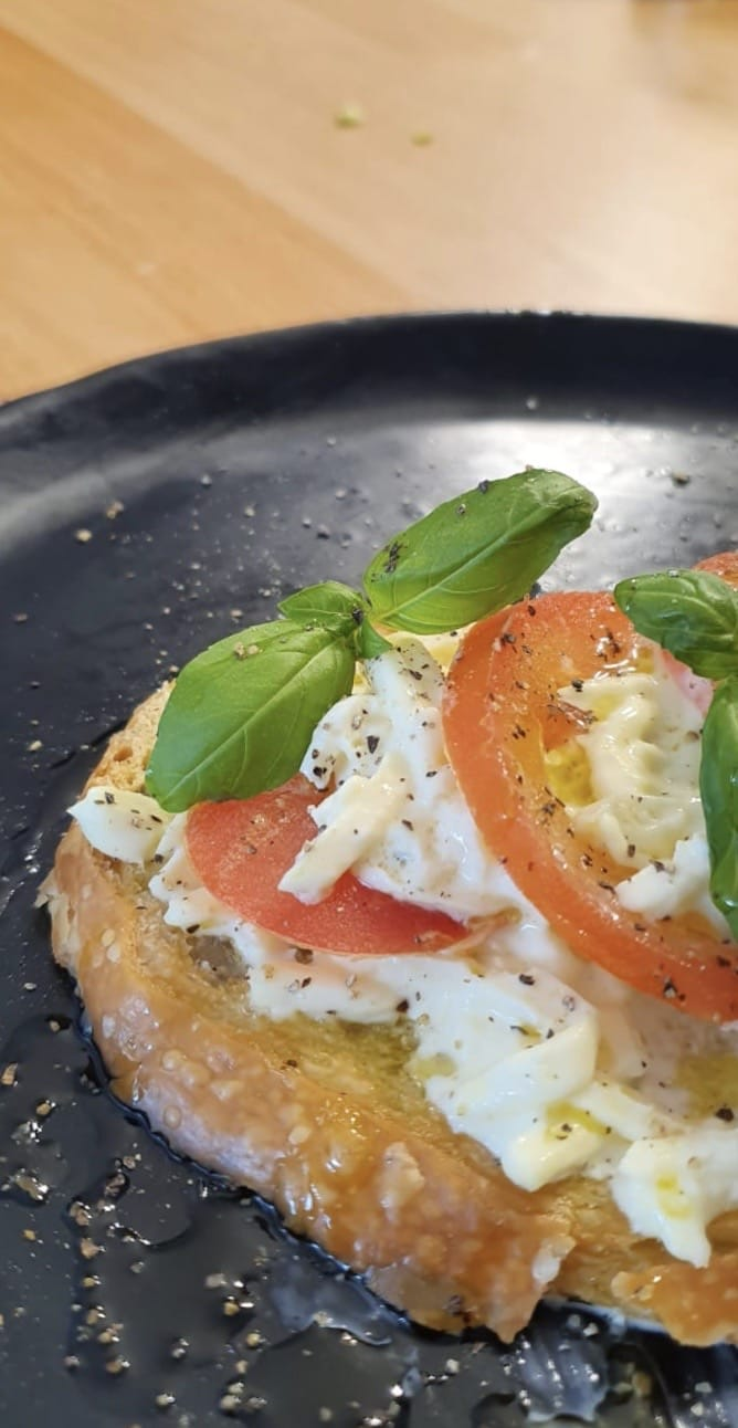 Bruschetta Stracciatella, Fresh Tomatoes and basil